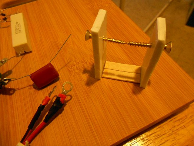 Image: A spark gap jig holds the frame in place for mounting. Brass wood screws as electrodes, following Tesla specs...