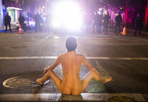 Image: Naked Athena vs Trump's Gestapo. Photo by Dave Killen, The Oregonian...