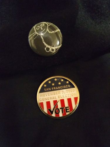 Image: My pollworker pin. Still wearing it because the election drama is ongoing...