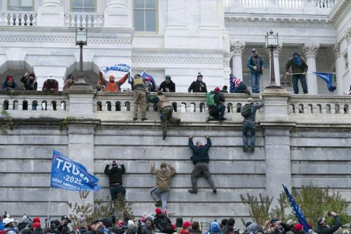 Image: tRump thugs assault Capitol on Jan. 6th. Pic by Jose Luis Magana, AJC...